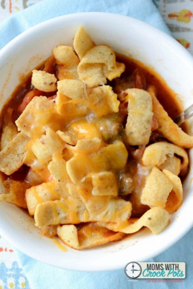 Kid friendly, mom approved. You have to try this yummy Crockpot Frito Pie Recipe for dinner tonight!