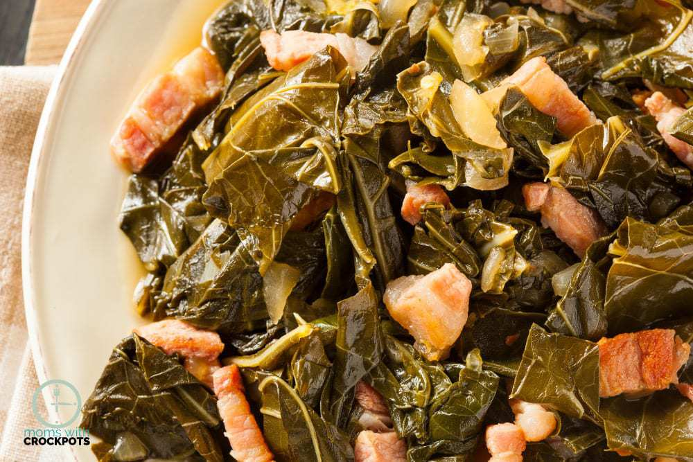 A southern classic especially during the holidays! Give this simple yet delicious Crockpot Collard Greens Recipe a try! The slow cooker makes them amazing!