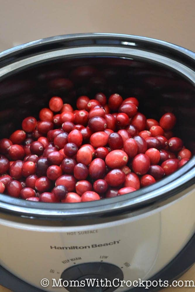 Simple and delicious! Perfect for the holidays! This Crockpot Cranberry Sauce recipe is one of the easiest things you will ever make in a slow cooker!