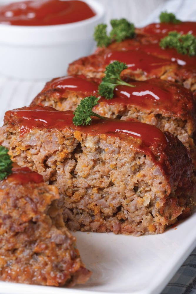 A classic dinner recipe made even easier in the slow cooker! Try this delicious and easy to make Crockpot Meatloaf Recipe! | @MomsWCrockpots #crockpot #slowcooker #dinner #beef #glutenfree