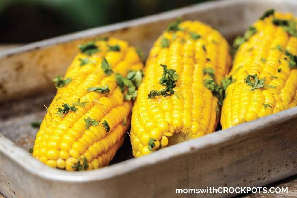 The best way to cook corn on the cob! Try this delicious Crockpot Corn on the Cob Recipe the next time you are cooking!