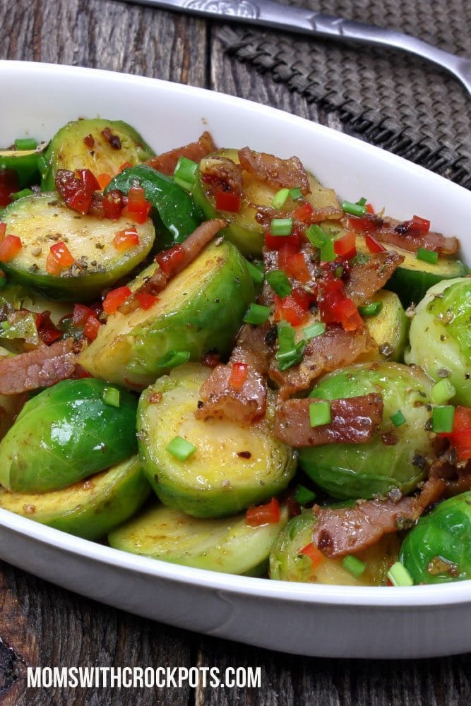 Amazing crockpot side dish! Try this Crockpot Brussels Sprouts recipe with bacon! YUM!