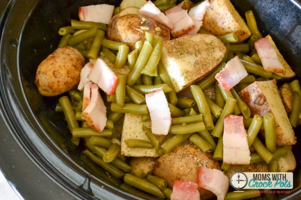 A dump and go crockpot recipe that the whole family will love! This Crockpot Ranch Chicken Dinner has the meat, potatoes, and veggies all rolled into one delicious meal. Plus its gluten free & dairy free!
