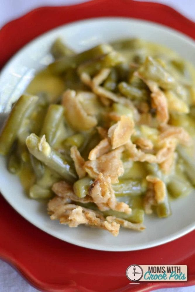 Free up some oven space this holiday and make this Crockpot Green Bean Casserole Recipe! Perfect for any night of the week!
