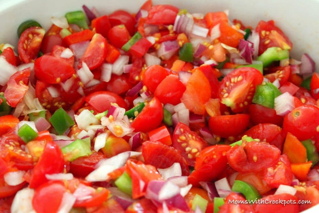 It's that time of year when gardens are pouring with tomatoes! Don't let them go to waste! Pull out your crockpot and make this delicious Crockpot Salsa Recipe!