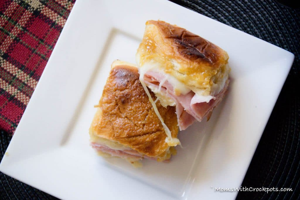 Perfect slow cooker solution for the holidays, parties, or game day! This simple recipe for Crockpot Party Sandwiches will have them begging for more!