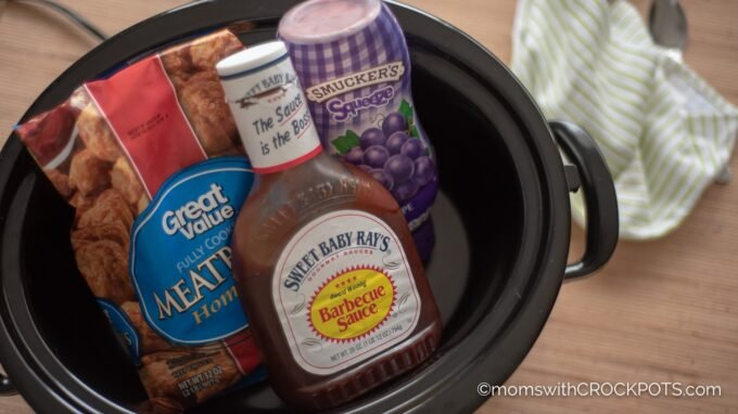A classic slow cooker appetizer that is perfect for any get together! This simple Crockpot Grape Jelly & BBQ Meatballs Recipe is delicious! | @MomsWCrockpots #crockpot #Slowcooker #recipes #appetizer #gameday #glutenfree #bbq