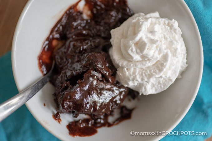 Crockpot Chocolate Lava Cake in a bowl with whipped cream