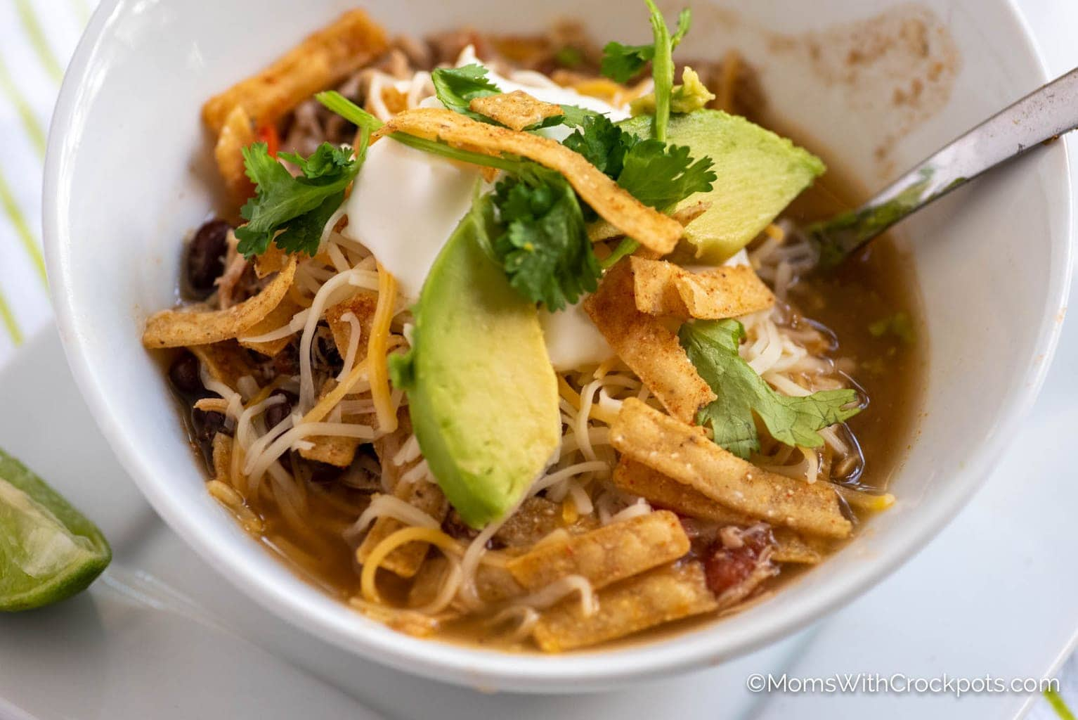 Crockpot Chicken Tortilla Soup with toppings
